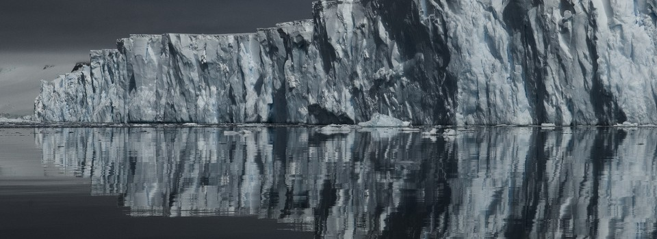 Sheldon Glacier reflected in the glassy waters of Ryder Bay, Adelaide Island, Antarctica. Photo: Pete Bucktrout, British Antarctic Survey.